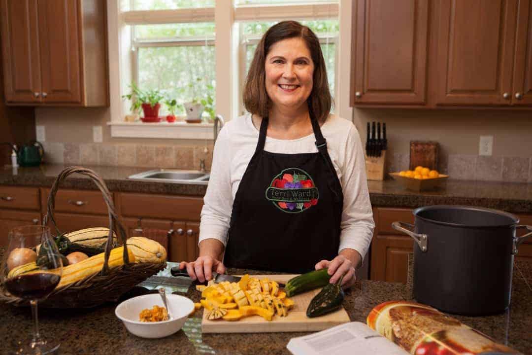 Terri Ward cutting vegetables