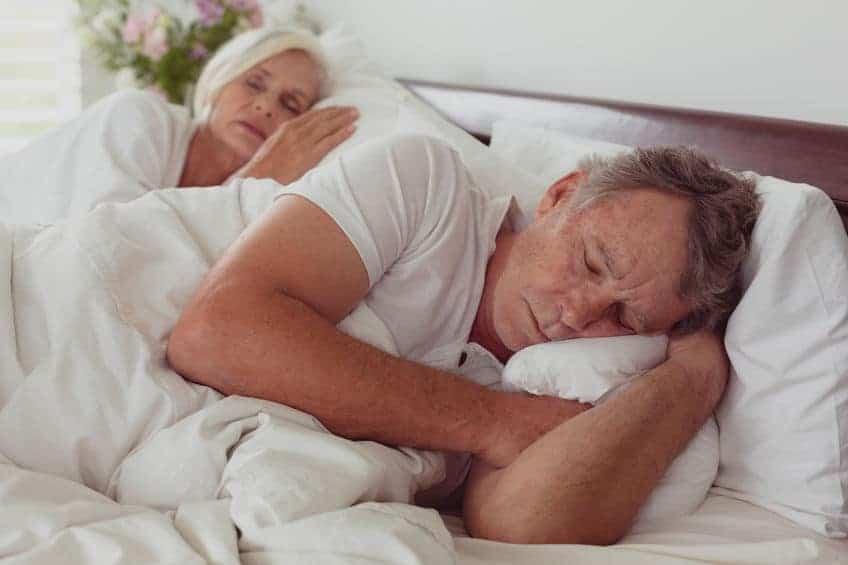 Elderly Couple in Bed Sleeping